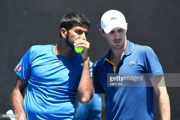 Rohan Bopanna of India and Edouard RogerVasselin of France talk tactics in their first round men's doubles match against Ryan Harrison of the United...