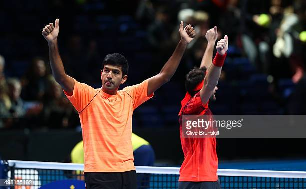 Rohan Bopanna of India and Florin Mergea of Romania celebrate their straight sets victory against Ivan Dodig of Croatia and Marcelo Melo of Brazil...