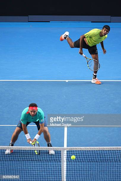 Rohan Bopanna of India and Florin Mergea of Romania compete in their first round match against Omar Jasika of Australia and Nick Kyrgios of Australia...