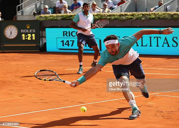 Rohan Bopanna of India and Florin Mergea of Romania in action during their three set victory against Marcin Matkowski of Poland and Nenad Zimonjic of...