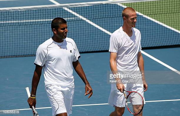 Rohan Bopanna of India and Kristof Vliegen of Belgium react after winning a point against Jonathan Erlich of Israel and Janko Tipsarevic of Serbia on...