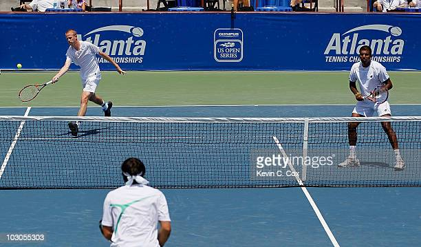 Rohan Bopanna of India and Kristof Vliegen of Belgium return a shot to Jonathan Erlich of Israel and Janko Tipsarevic of Serbia on Day 5 of the...