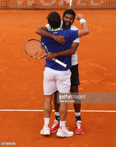 Rohan Bopanna of India and Pablo Cuevas of Uruguay celebrate match point against Feliciano Lopez and Marc Lopez of Spain in the doubles final on day...