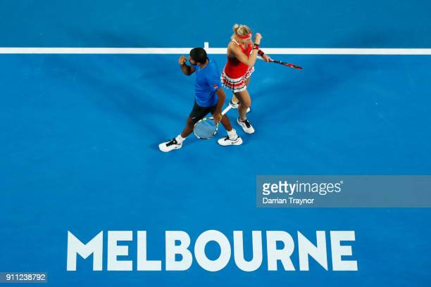 Rohan Bopanna of India and Timea Babos of Hungary celebrate winning a point in their mixed doubles final against Gabriela Dabrowski of Canada and...