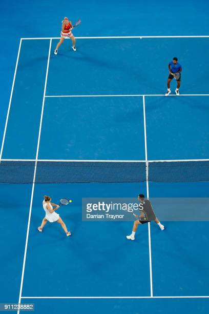 Rohan Bopanna of India and Timea Babos of Hungary compete in their mixed doubles final against Gabriela Dabrowski of Canada and Mate Pavic of Croatia...
