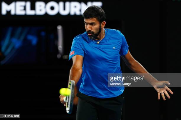 Rohan Bopanna of India plays a backhand in the mixed doubles final with Timea Babos of Hungary against Gabriela Dabrowski of Canada and Mate Pavic of...