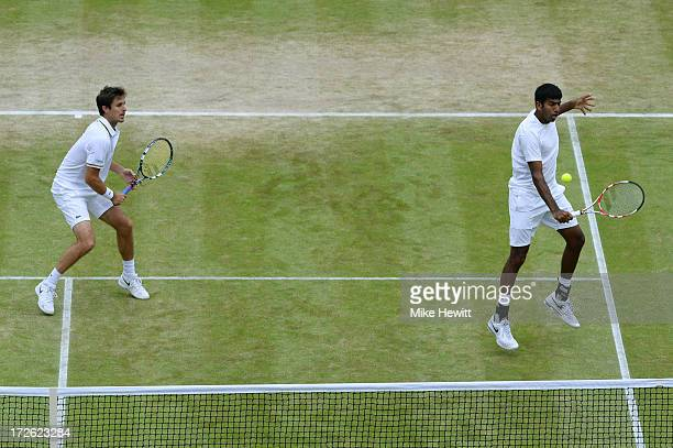 Rohan Bopanna of India plays a backhand next to teammate Edouard RogerVasselin of France during the Gentlemen's Doubles semi final match against Bob...