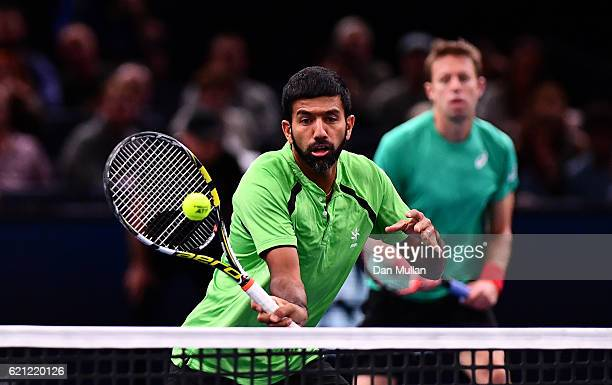 Rohan Bopanna of India plays a forehand against PierreHughes Herbert and Nicolas Mahut of France during the Mens Doubles semi final match on day six...