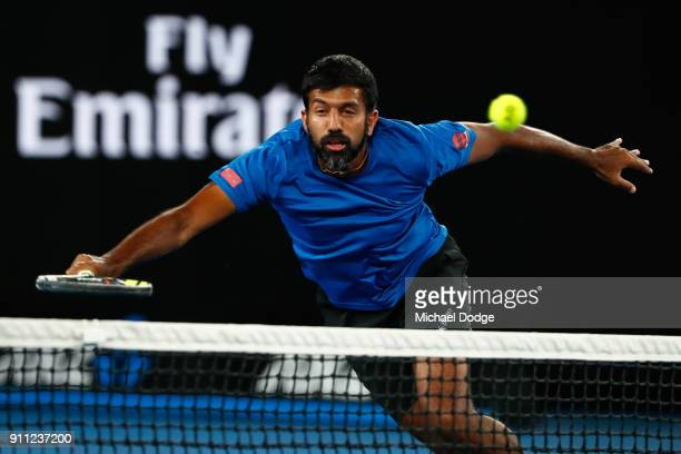 Rohan Bopanna of India plays a forehand in the mixed doubles final with Timea Babos of Hungary against Gabriela Dabrowski of Canada and Mate Pavic of...