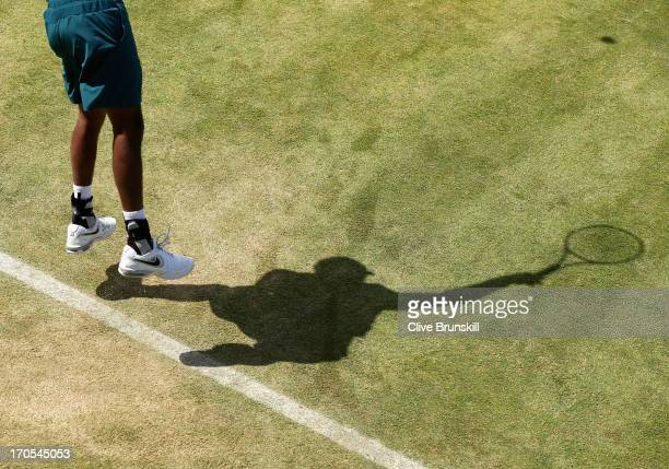 Rohan Bopanna of India serves during the Men's Doubles quarter final round match with Mahesh Bhupathi of India against Colin Fleming of Great Britain...