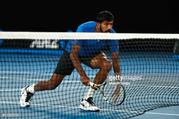 Rohan Bopanna of India waits at the net in the mixed doubles final with Timea Babos of Hungary against Gabriela Dabrowski of Canada and Mate Pavic of...
