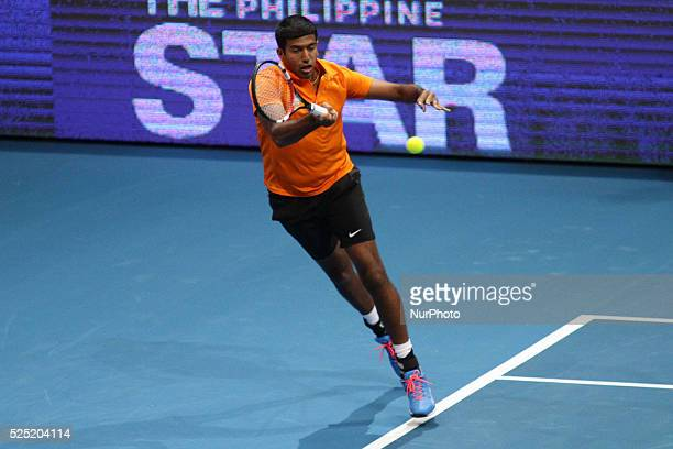 Rohan Bopanna of the Indian Aces makes a forehand return to Bruno Soares and Daniela Hantuchov�� of the Singapore Slammers during their mixed doubles...