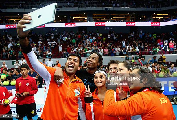 Rohan Bopanna of the Indian Aces takes a team selfie after their victory against the Manila Mavericks during the CocaCola International Premier...