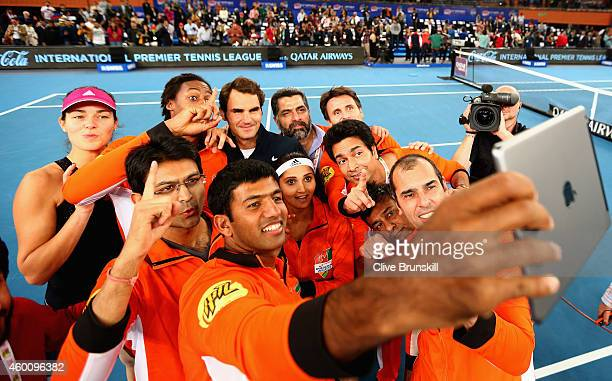 Rohan Bopanna of the Indian Aces taks a group selfie after Roger Federers victory in his match against Tomas Berdych of the Singapore Slammers during...