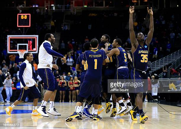 Rohan Brown of the La Salle Explorers celebrates with his teammates after they won 7674 against the Mississippi Rebels during the third round of the...
