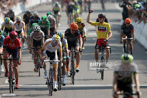 Rohan Dennis of Australia riding for BMC Racing celebrates as he crosses the finish line in stage seven to win the overall race leader's jersey of...