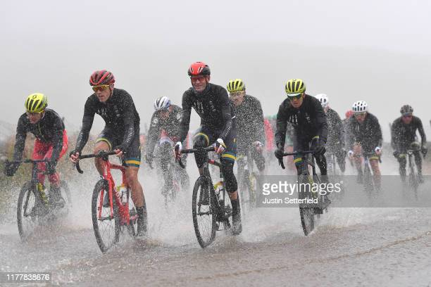 Rohan Dennis of Australia / Rory Sutherland of Australia / Simon Clarke of Australia / Flooded race route on Cray Summit / Rain / Water / Peloton /...