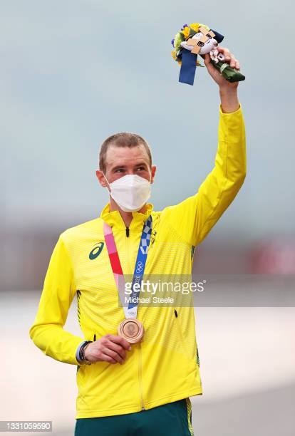 Rohan Dennis of Team Australia poses with the bronze medal after the Men's Individual time trial on day five of the Tokyo 2020 Olympic Games at Fuji...