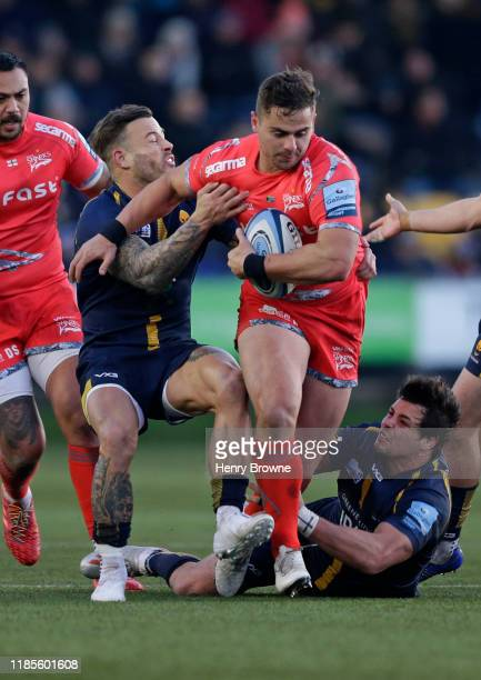 Rohan Janse van Rensburg of Sale Sharks is tackled by Francois Venter and Francois Hougaard of Worcester Warriors during the Gallagher Premiership...