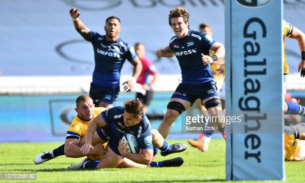 Rohan Janse van Rensburg of Sale Sharks scores their first try of the game during the Gallagher Premiership Rugby match between Sale Sharks and Bath...