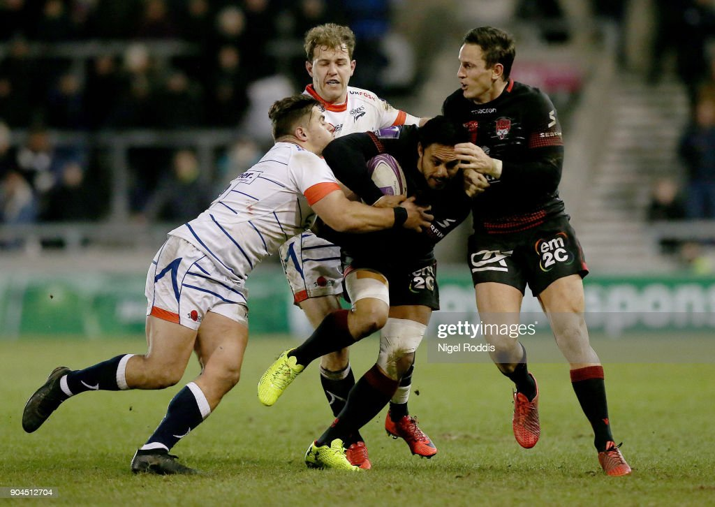 Rohan Janse Van Rensburg (L) of Sale Sharks tackles Rudi Wulf of Lyon during the European Rugby Challenge Cup match between Sale Sharks and Lyon at the AJB Stadium on January 13, 2018 in Salford, United Kingdom.