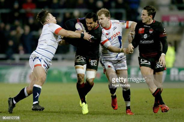 Rohan Janse Van Rensburg of Sale Sharks tackles Rudi Wulf of Lyon during the European Rugby Challenge Cup match between Sale Sharks and Lyon at the...