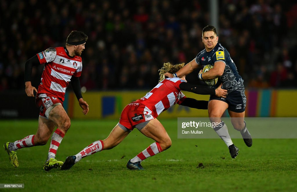 Rohan Janse van Rensburgh of Sale Sharks is tackled by Billy Twelvetrees of Gloucester during the Aviva Premiership match between Gloucester Rugby and Sale Sharks Sharks at Kingsholm Stadium on December 30, 2017 in Gloucester, England.