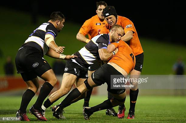 Rohan O'Reegan of the Eagles is tackled by Billy Meakes of the Spirit during the 2016 NRC Grand Final match between the NSW Country Eagles and Perth...