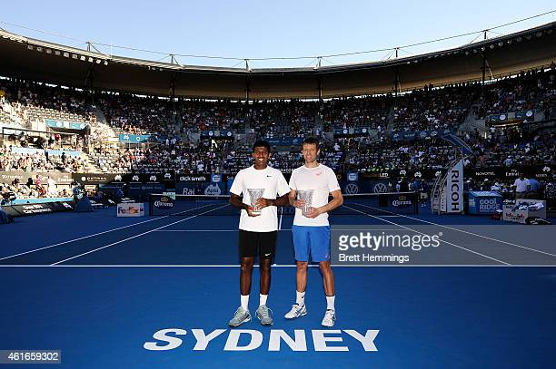 Rohan Popanna of India and Daniel Nestor of Canada pose for a photo with the APIA International Trophy after victory in their doubles final against...