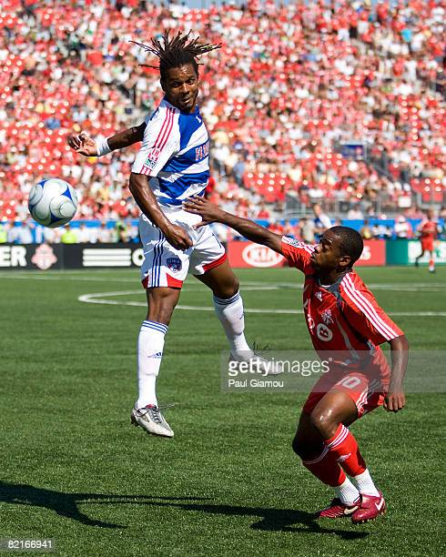 Rohan Ricketts of Toronto FC watches the ball sail past Adrian Serioux of FC Dallas during the match on August 3 2008 at BMO Field in Toronto Ontario...