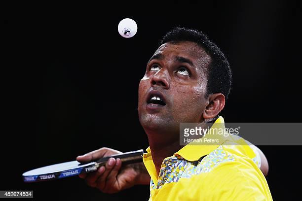 Rohan Sirisena of Sri Lanka serves against Gavin Rumgay of Scotland during the Men's Teams first round table tennis match between Scotland and Sri...