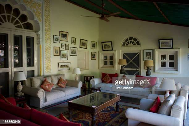 Rohet Garh fortress palace hotel salon drawing room with photographs of aristocratic ancestors Rohet Rajasthan India