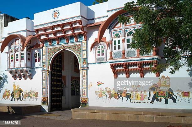 Rohet Garh fortress palace hotel with battlement walls with drawings of aristocratic ancestors Rohet Rajasthan Northern India