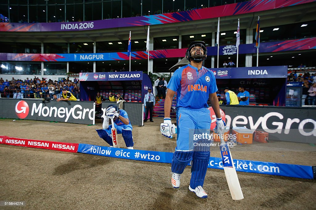 Rohi Sharma of India (R) and Shikhar Dhawan of India walk out onto the pitch to open the batting during the ICC World Twenty20 India 2016 Group 2 match between New Zealand and India at the Vidarbha Cricket Association Stadium on March 15, 2016 in Nagpur, India.