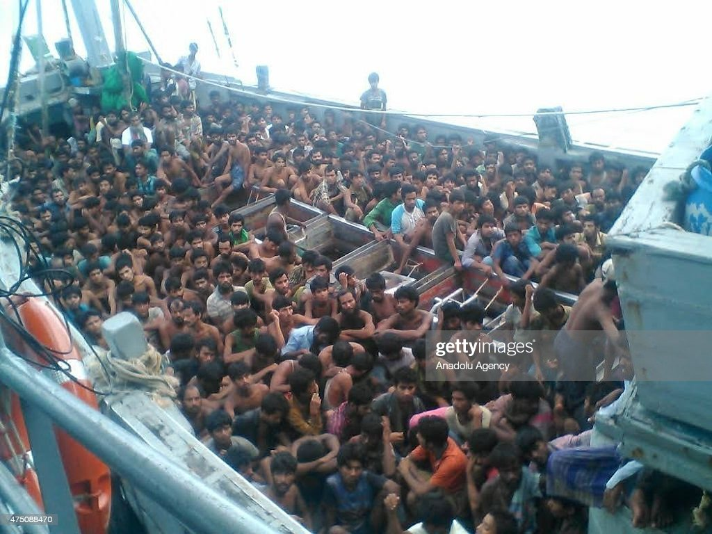 Rohingya and Bangladeshi migrants are seen after Myanmar's navy seizes a boat with 727 migrants off the country's southern coast near the city of Yangon, Myanmar on 29, 2015.