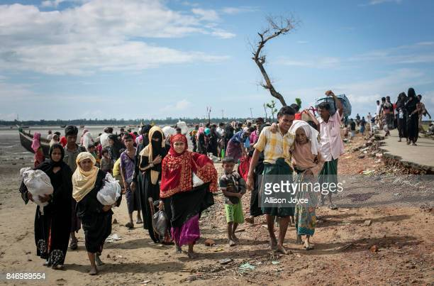 Rohingya are seen after arriving on a boat to Bangladesh on September 14 2017 in Shah Porir Dip Bangladesh Around 370000 Rohingya refugees have fled...