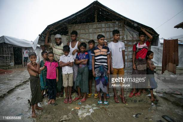 Rohingya are seen during a rainstorm at the Nayapara refugee camp on August 21, 2019 in Cox's Bazar, Bangladesh. Rohingya refugees said on August...