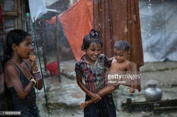 COX'S BAZAR BANGLADESH AUGUST 21 Rohingya are seen during a rainstorm at the Nayapara refugee camp on August 21 2019 in Cox's Bazar Bangladesh...