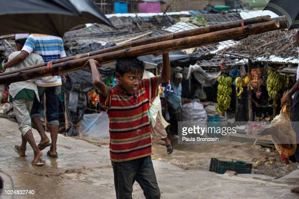 Rohingya boy carries wood through a market August 28 2018 in Unchiprang refugee camp Cox's Bazar Bangladesh UN investigators said on Monday that...
