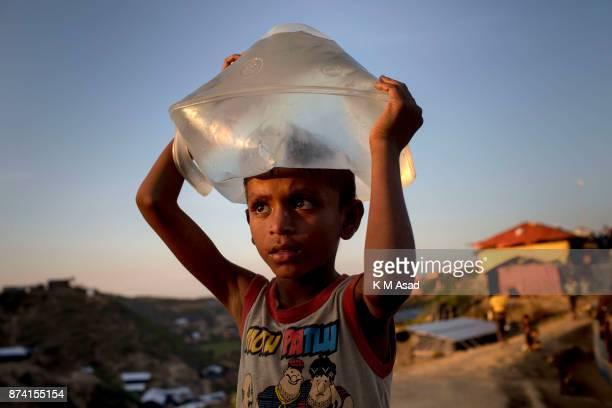 A rohingya boy carry drinking water at Hakimpara Rohingya refugee camp in Ukhia district Coxsbazar Bangladesh on More than 615000 Rohingya refugees...
