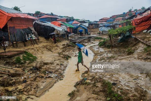 A Rohingya boy is walking on the canel nside the kutupalong makeshift shelter in Coxs Bazar Bangladesh on June 13 2018