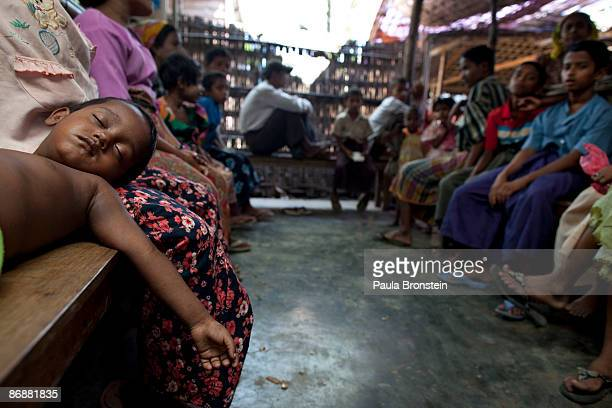Rohingya boy suffering from malaria sleeps while waiting for treatment at special clinic for malaria on May 4 2009 in Sittwe Arakan state Myanmar The...