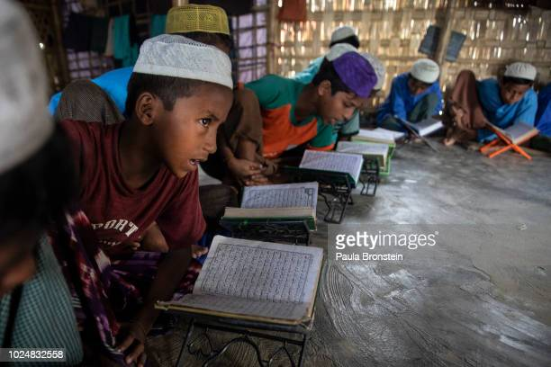 Rohingya boys attend religious studies at a madrassa August 28 2018 in Unchiprang refugee camp Cox's Bazar Bangladesh UN investigators said on Monday...