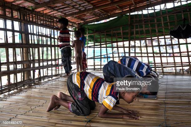 Rohingya boys pray at a local mosque August 27 2018 in Kutupalong Cox's Bazar Bangladesh UN investigators said on Monday that Myanmars army had...