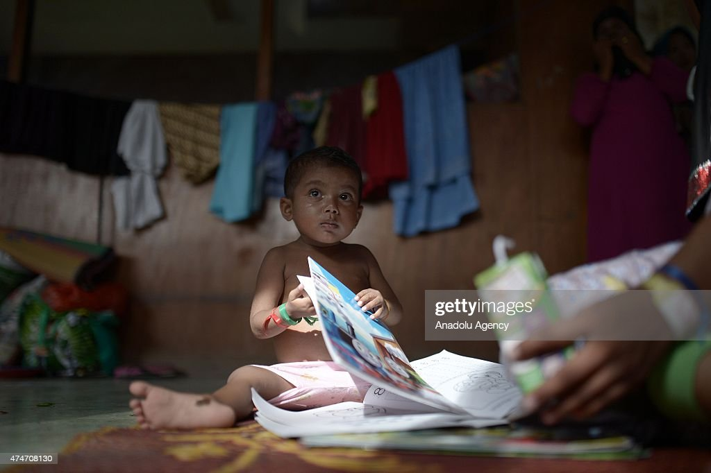 A Rohingya child migrant plays at Bayeun shelters in Aceh, Indonesia on May 25, 2015. Indonesia has begun search and rescue operations for stranded migrant boats carrying Bangladeshis and ethnic Rohingya from Myanmar, an official said.