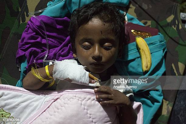 Rohingya child sleeps in a temporary medical clinic after receiving medical aid, in Kuala Langsa Port in Langsa, Aceh province, Indonesia on May 17,...