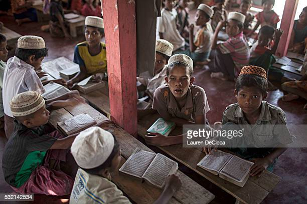 Rohingya children attend Arabic school in the Dar Paing unregistered internal displacement camp on May 17 2016 in Sittwe Burma Despite the US...