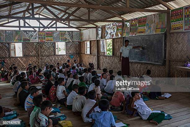 Rohingya children attend school at the 23rd Temporary Learning School in the Dar Paing unregistered internal displacement camp on May 17 2016 in...