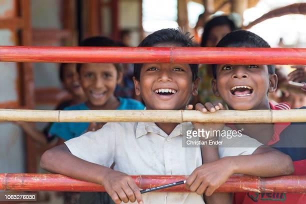 Kutupalong Ukhiya near Cox´s Bazar Bangladesh October 16 2018 Rohingya children behind a grid in the refugee camp of the Rohingya people near Cox's...