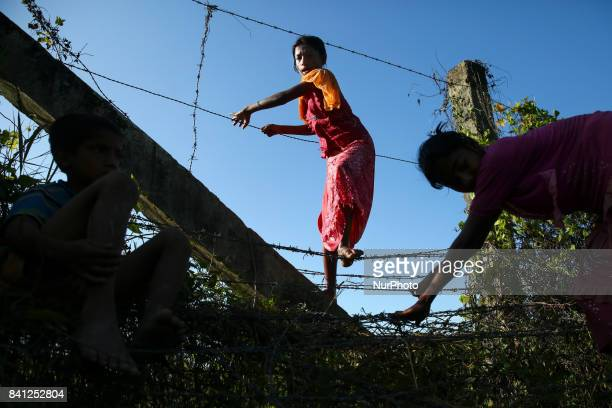 Rohingya children cross the BangladeshMyanmar border fence as they try to enter Bangladesh in BangladeshMyanmar border on 30 August 2017 UN refugee...